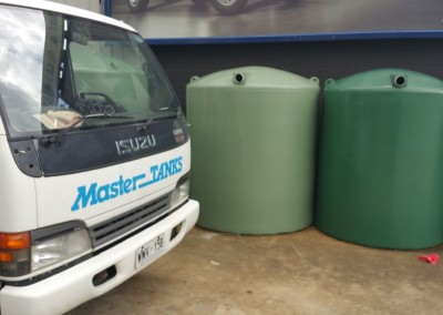 Green poly tanks ready for delivery and fitting in suburban Adelaide - Glen Osmond